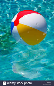 beach ball in pool. Beach Ball Floating In Pool With Reflection F