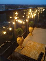 balcony lighting ideas. lamps lights string balcony vases plants chair rug lighting ideas