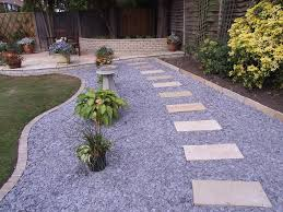 An English garden is cozy with a gravel road look, paving stones fit  perfectly to