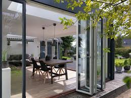 modern sunroom with siding and exterior contractors