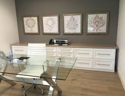 office remodel. Feminine Office Remodel: Glass Top Desk; Storage; Framed Art; Herman Miller High Remodel E