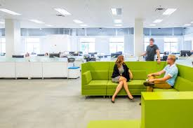 define office. within the large open office plan furnishings are used to define space for gathering n