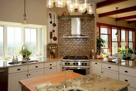View in gallery Farmhouse kitchen with corner range and hood [Design: Smith  & Robertson]