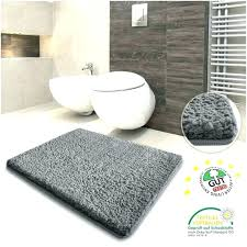 black bathroom rug set and white bath rugs