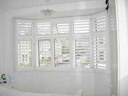 Bay Window Coverings  Treatments For Bay Windows  Budget BlindsBay Window Vertical Blinds