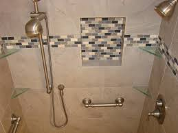 interior four corner glass shower shelves on beige ceramic tile wall connected by grey mozaic