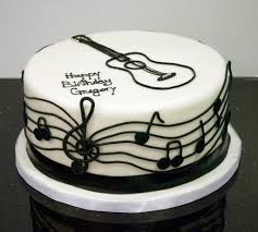 a black and white musical guitar cake for a musician s birthday a black and white musical guitar cake for a musician s birthday