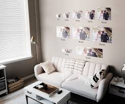 wall gallery above a couch of diffe sized photos