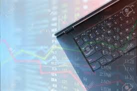Laptop For Finance Use And Stock Trading With Market Charts Overlay