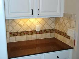 accent tile backsplash this kitchen has tumbled marble tiles with three rows of small glass tiles