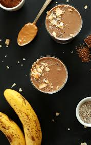 gles of vegan chocolate chia recovery drink surrounded by ings used to make it