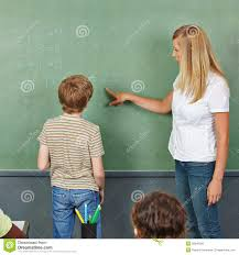 helping math teacher helping child at chalkboard stock photo  teacher helping child at chalkboard stock photo image teacher helping child at chalkboard