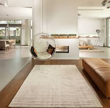 living rooms awesome minimalist living room with hanging bubble chairs and white rug also brown