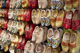 for hundreds of years wooden shoes called klompen were worn by most dutch people for very practical purposes because much of holland lies below sea