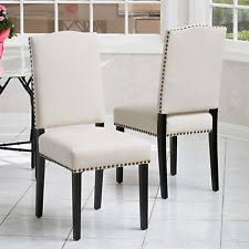 leather dining chairs elegant gold set of  elegant beige fabric upholstered dining chairs w nailheads