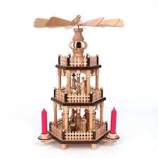 Erzgebirge Christmas Pyramids And Candelabra At The Wooden Wagon