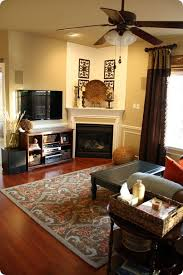 decorating a living room with a corner fireplace meliving intended for corner fireplace decor for property