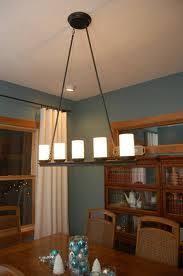 lighting over dining room table. impressive line candle chandelier as dining room lights uk above light brown hardwood table with blue balls jar decoration magnificent lighting over