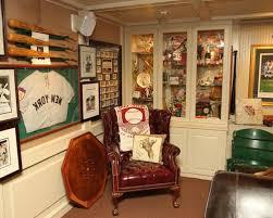 sports office decor. Sports Office Decorating Ideas 59c1fc4c0faaad42 3989 W500 H400 B0 P0 Traditional Basement Decor O