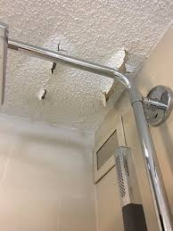 the westin chicago northwest crumbling ceiling towel rack falling off tile coming off