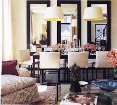 three mirrors on dining room wall