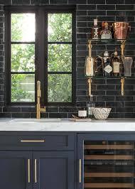 glossy black wet bar with glass and brass shelves bathroom shelf