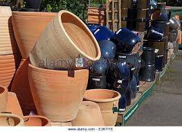 garden plant pots for sale. plant pots and containers on sale in a garden centre - stock image for d