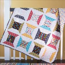 10 Fabulous Fat Quarter Quilt Patterns | FaveQuilts.com & Retro Spools Lap Quilt Pattern Adamdwight.com