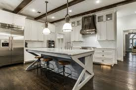 cottage kitchen with white cabinets breakfast bar island and carrara marble counters
