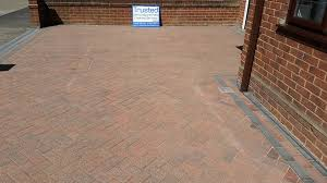 power wash to remove all the moss and weeds then the brick paving was resanded as always we had another very happy customer
