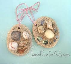 Make clay, cut out the shape you want and then press the shells into it.