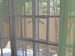 screen with hinged door to reach window handles