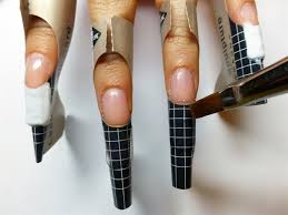 start by applying sculpting gel to extend the natural nail on a form to the desired