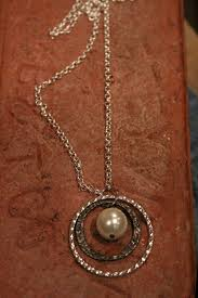 antique silver pendant necklace with pearl center stone