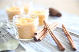 a burning candle can really cozy a house up especially during the winter months learn how to make the easiest beeswax candles with this tutorial and