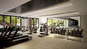 Comfortable Modern Gym Room Design with Gray Carpet and Cream Wall also  Glass Window Idea