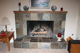 masonry fireplace with slate facing and gas log already installed