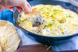 with great es and flavors this chile relleno dip would be an amazing hit when cheering on the cardinals