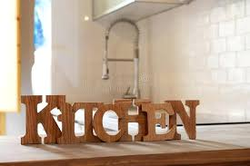 kitchen wooden letters word kitchen made from wooden letters on the wooden table in the kitchen stock image wooden letters kitchen eat