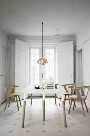 in between chair by sami kallio raft table by norm architects and flowerpot pendant by verner panton all designed for tradition