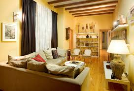 Yellow Walls Living Room Interior Decor Living Room Yellow Painted Wall With White Leather Cushion Also