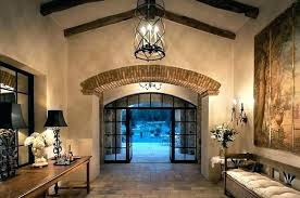 front door chandelier gorgeous entryway with high ceilings tall dark wood floors