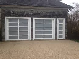 there are many diffe materials to choose from when choosing a hamptons garage door wood steel aluminum etc what makes an aluminum garage door so