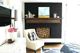 black brick fireplace black paint was perfect for this old outdated fireplace makeover black brick fireplace black brick fireplace fireplace brick painted