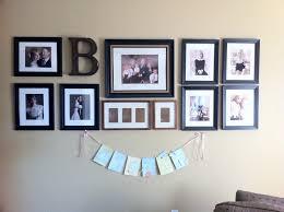 beauteous accessories for living room decoration using cream interior wall paint including wedding picture collage wall decor and initial letter wall