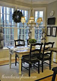 like the black chairs with the white distressed table legs
