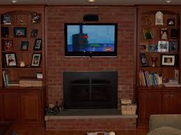 sound system cabinets. custom oak cabinets to flank the fireplace. we also added hardwood floor and set up surround sound entertainment system. system c