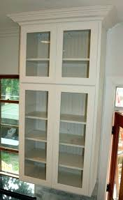 wall cabinet with glass doors oak display