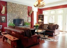 decorating a red living room with cowhide rug and brown leather sofa