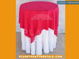 white round tablecloth on cocktail table with fuchsia overlay tablecloth linen als